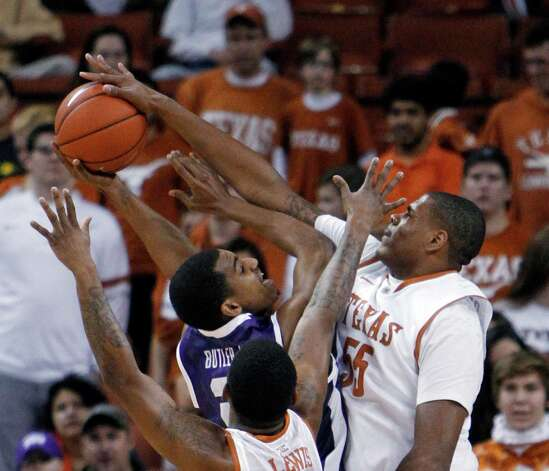 TCU's Nate Butler Lind has his shot stopped by Texas' Cameron Ridley during the first half of an NCAA college basketball game, Saturday, Feb. 2, 2013, in Austin, Texas. (AP Photo/Michael Thomas) Photo: Michael Thomas, Associated Press / FR65778 AP