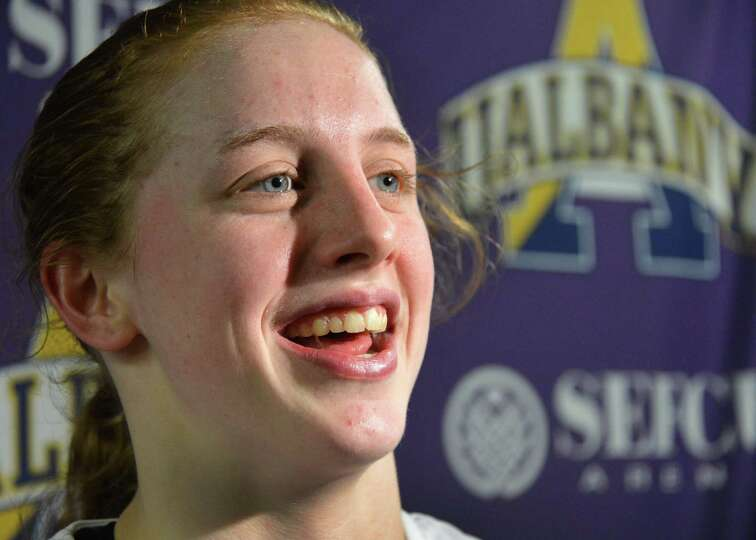 UAlbany's Julie Forster speaks with the media after scoring her 1000th point during a game against B