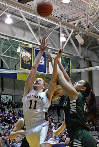 UAlbany's Julie Forster scores her 1000th point during a game against Binghamton at SEFCU arena in Albany Saturday Feb. 2, 2013.  (John Carl D'Annibale / Times Union) Photo: John Carl D'Annibale