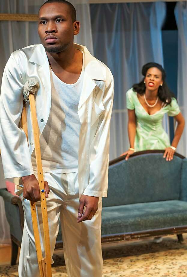 "Maggie (ZZ Moor, right) and her husband Brick (Tyrone Davis) navigate their tense relationship in African-American Shakespeare Company's ""Cat on a Hot Tin Roof"" Photo: Lance Huntley"