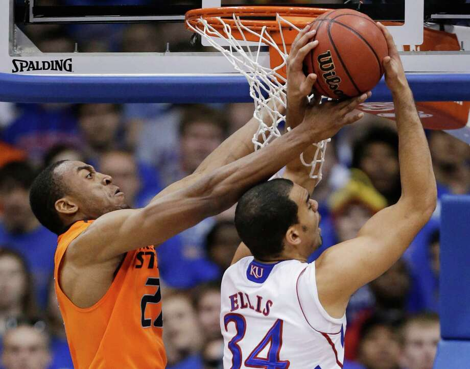 Oklahoma State guard Markel Brown (22) blocks a shot by Kansas forward Perry Ellis (34) during the second half of an NCAA college basketball game in Lawrence, Kan., Saturday, Feb. 2, 2013. Oklahoma State won 85-80. (AP Photo/Orlin Wagner) Photo: Orlin Wagner