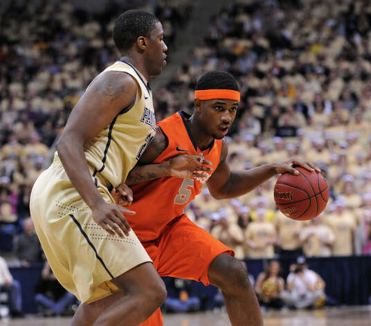 Pittsburgh's Lamar Patterson, left, guards Syracuse C.J. Fair, right, during NCAA college basketball game in Pittsburgh, Saturday, Feb. 2, 2013.  (AP Photo/John Heller) Photo: John Heller