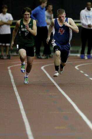 Mike Ross Connecticut Post freelance -New Fairfield's James Colella, right competes against New Milford's David Baxter during 55 Meter Dash heat at Saturday's SWC Indoor Track Championships held at Floyd Little Athletic Center in New Haven. Photo: Mike Ross / @www.mikerossphoto.com