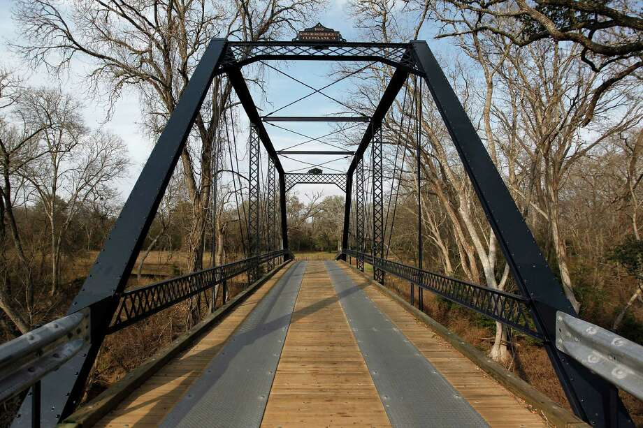 "Fayette County's old Piano Bridge, dating to 1885, is among more than 1,000 structures highlighted in the first volume of ""Buildings of Texas,"" written by and including 300-plus photos by Houston architect Gerald Moorhead. Photo: Johnny Hanson, Staff / © 2013  Houston Chronicle"