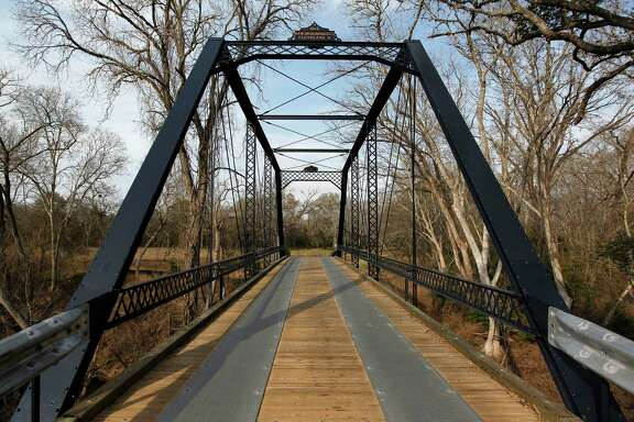 """Fayette County's old Piano Bridge, dating to 1885, is among more than 1,000 structures highlighted in the first volume of """"Buildings of Texas,"""" written by and including 300-plus photos by Houston architect Gerald Moorhead."""