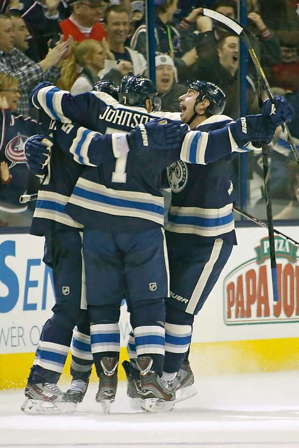Columbus players celebrate Mark Letestu's shorthanded third-period goal that padded the Blue Jackets' lead over the Red Wings en route to their third win this season. Photo: Kirk Irwin, Getty Images