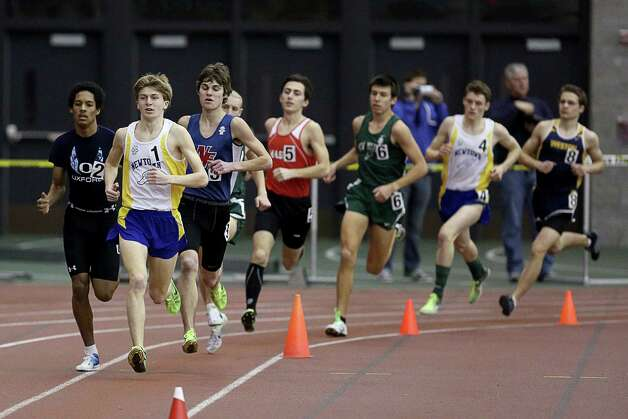 Mike Ross Connecticut Post freelance -Newtown's Jake Feinstein leads the pack during the Boys 1600 Meter Run during Saturday's SWC Indoor Track Championship held in New Haven. Photo: Mike Ross / @www.mikerossphoto.com