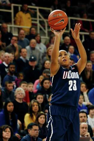 Connecticut forward Kaleena Mosqueda-Lewis (23) shooots during the second half of a NCAA college basketball game against St. John's, Saturday, Feb. 2, 2013, at St. John's University in New York. Connecticut defeated St. John's 71-65. (AP Photo/John Minchillo) Photo: John Minchillo, Associated Press / FR170537 AP
