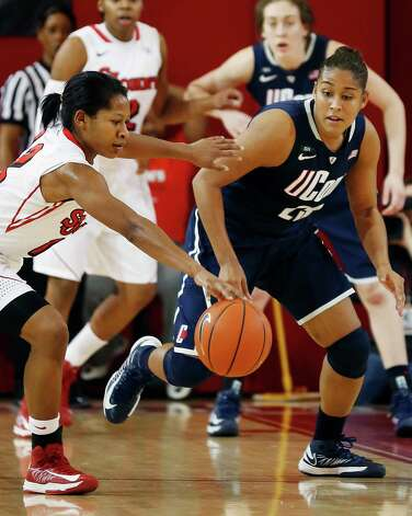St. John's guard Briana Brown (12) and Connecticut forward Kaleena Mosqueda-Lewis (23) reach for the ball during the second half of their NCAA college basketball game, Saturday, Feb. 2, 2013, at St. John's University in New York. (AP Photo/John Minchillo) Photo: John Minchillo, Associated Press / FR170537 AP