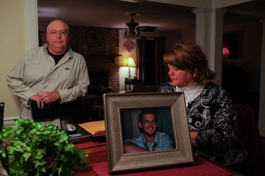 Kathy and Rick Fee in their home with a photograph of their son, Richard, who committed suicide in 2011, in Virginia Beach, Va., Nov. 27, 2012. The suicide of Richard Fee highlights issues in the diagnosis and treatment of ADHD, as growing numbers of youths fake symptoms to obtain steady prescriptions for stimulants that carry serious psychological dangers. (Matthew Eich/The New York Times) Photo: MATT EICH / NYTNS