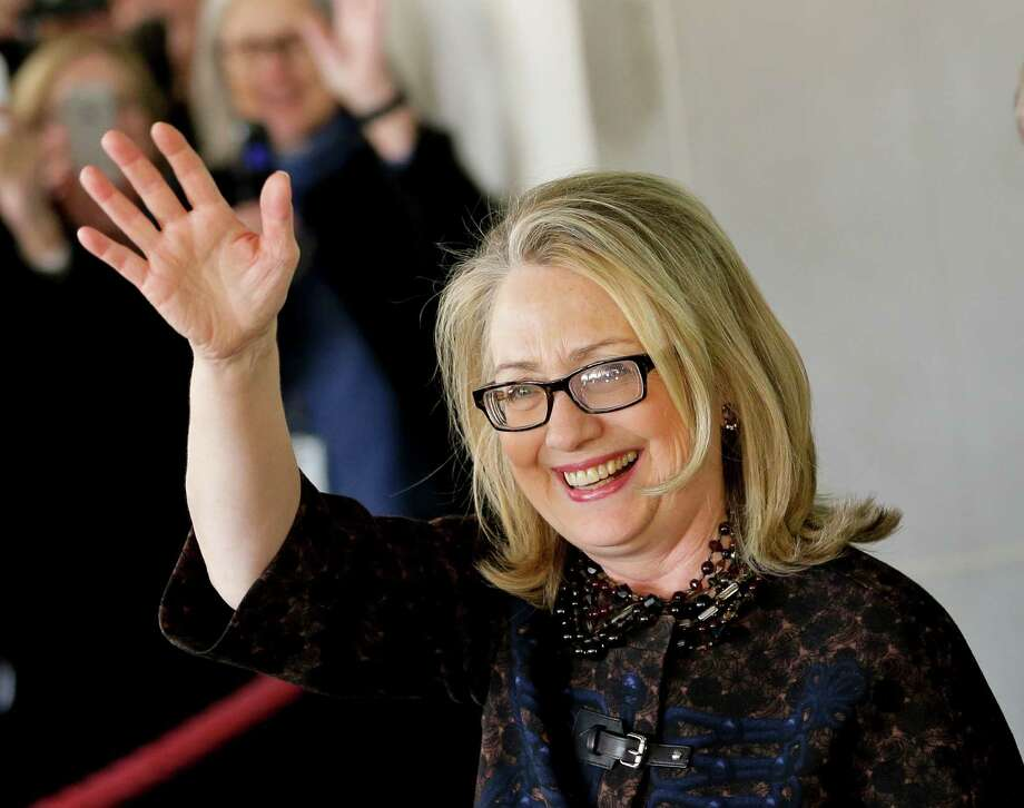 Outgoing Secretary of State Hillary Rodham Clinton waves as she leaves the State Department in Washington, Friday, Feb. 1, 2013, for last time as America's top diplomat. After four years, Clinton has traveled nearly one million miles to meet with leaders in over 100 countries. (AP Photo/J. Scott Applewhite) Photo: J. Scott Applewhite