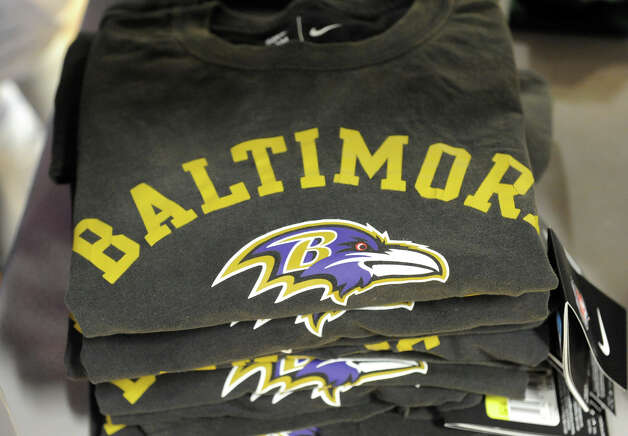 A Superbowl display with Baltimore Ravens and San Francisco 49ers hats and t-shirts at the   Sports Zone store in Colonie Center on Wednesday Jan. 30, 2013 in Colonie, N.Y. (Lori Van Buren / Times Union) Photo: Lori Van Buren