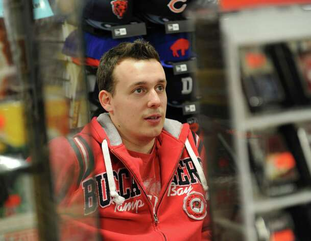Sports Zone store manager Jay Dent sits behind the front counter his store in Colonie Center on Wednesday Jan. 30, 2013 in Colonie, N.Y. (Lori Van Buren / Times Union) Photo: Lori Van Buren