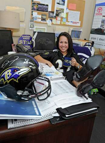 Baltimore Ravens fan Hisa Zhu sits at her desk in her office at BBL Construction on Thursday Jan. 31, 2013 in Albany, N.Y. (Lori Van Buren / Times Union) Photo: Lori Van Buren
