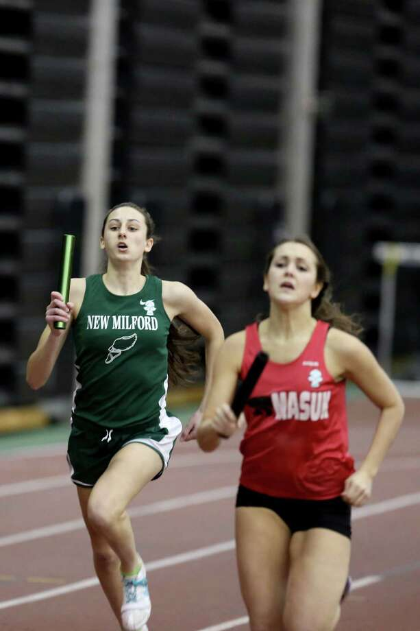Mike Ross Connecticut Post freelance -New Milford's Hannah Tower,left makes her way during Saturday's 4x800 Meter Relay at the SWC Indoor Track Championships. Photo: Mike Ross / @www.mikerossphoto.com