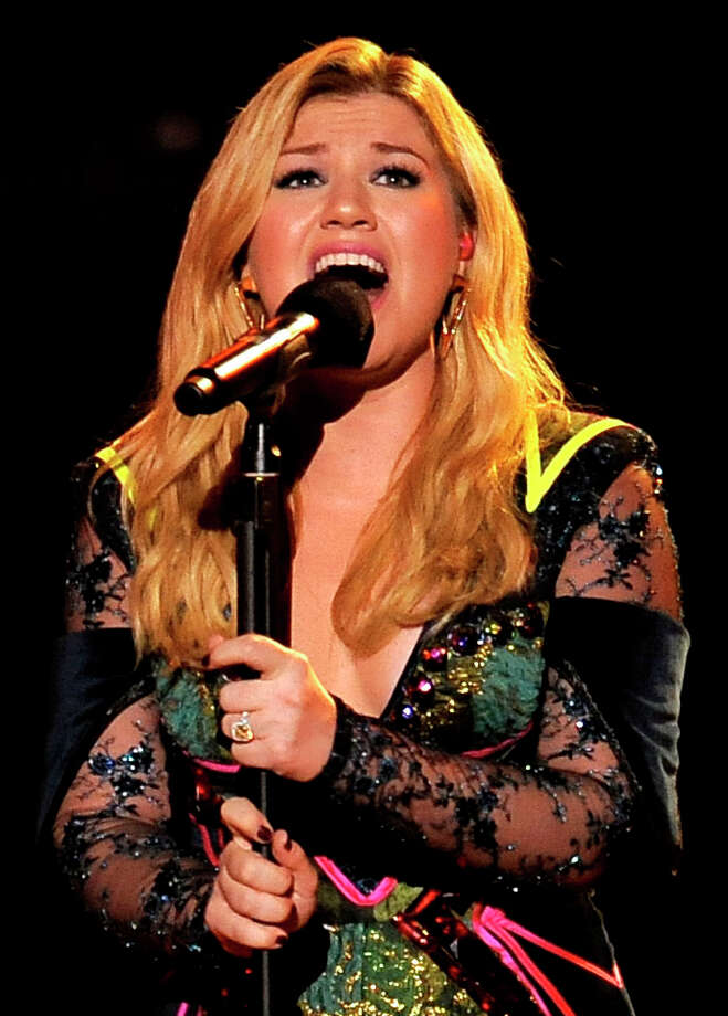 "FILE - In this Dec. 16, 2012 file photo, Kelly Clarkson performs at VH1 Divas at the Shrine Auditorium in Los Angeles. Kelly Clarkson's No. 1 hit, ""Stronger (What Doesn't Kill You),"" is nominated for record of the year at Grammy Awards on Feb. 10, 2013. The song is also up for song of the year and best pop solo performance, and her fifth album, ""Stronger,"" is nominated for best pop vocal album. (Photo by Chris Pizzello/Invision/AP, File) Photo: Chris Pizzello"