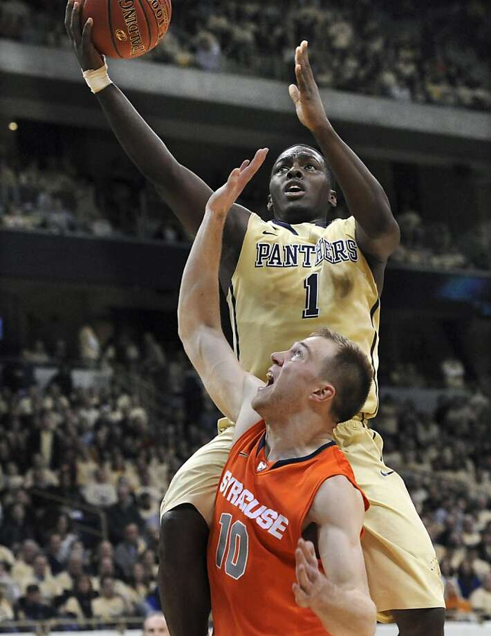 Pittsburgh's Tray Woodall, rear, shoots over Syracuse Trevor Cooney, front,  during an NCAA basketball game in Pittsburgh, Saturday, Feb. 2, 2013.  (AP Photo/John Heller) Photo: John Heller, Associated Press