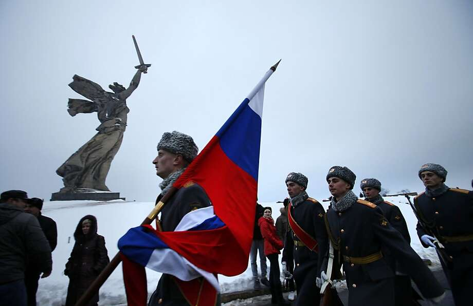 Russian soldiers march by the  monument to Motherland during ceremonies marking the 70th anniversary of the Battle of Stalingrad in the southern Russian city of Volgograd, once known as Stalingrad, Saturday, Feb. 2, 2013. Russia celebrates the 70th anniversary of  the end of one of modern warfare's bloodiest battles that was turning point in World War II and led to the defeat of the Nazi Germany.  Photo: Alexander Zemlianichenko, Associated Press