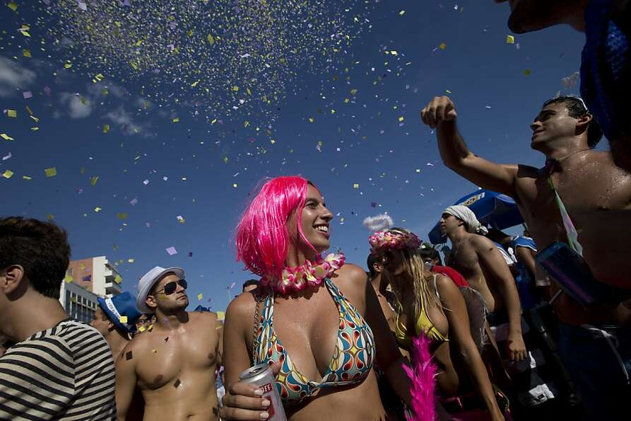Confetti rains down on a group of revelers at the Simpatia e Quase Amor or
