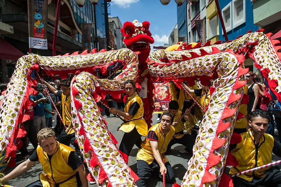 The dragon dance is performed during the Chinese lunar new year celebrations at Liberdade district in Sao Paulo, Brazil, on February 2, 2013. The Chinese lunar New Year's day will be February 10 as the year of snake in Chinese zodiac calendar. Photo: Yasuyoshi Chiba, AFP/Getty Images