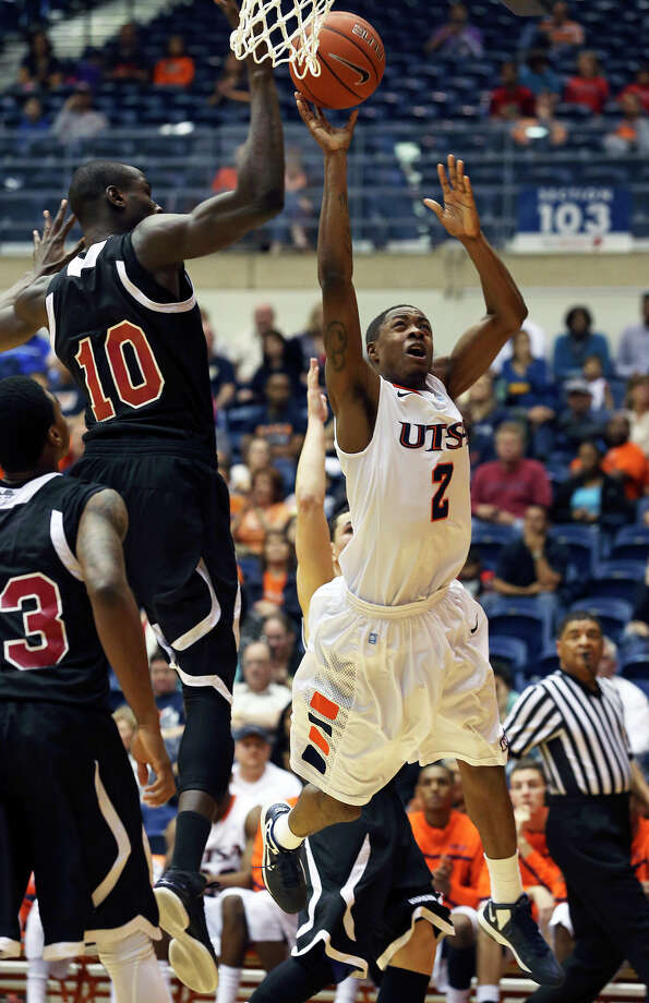 UTSA guard Hyjii Thomas runs into a block by Bandji Sy in the second half as the Roadrunners host New Mexico State on February 2, 2013. Photo: Tom Reel, Express-News / ©2012 San Antono Express-News