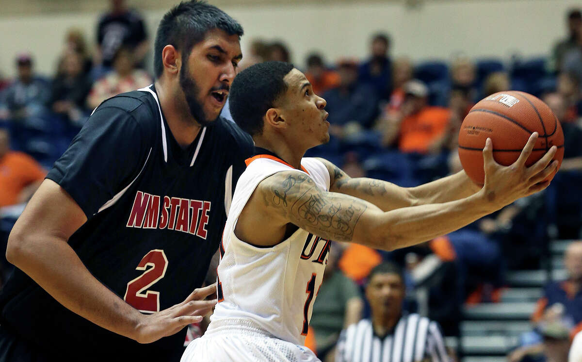 UTSA guard Michael Hale beats Sim Bhullar to the hoop in the second half as the Roadrunners host New Mexico State on February 2, 2013.