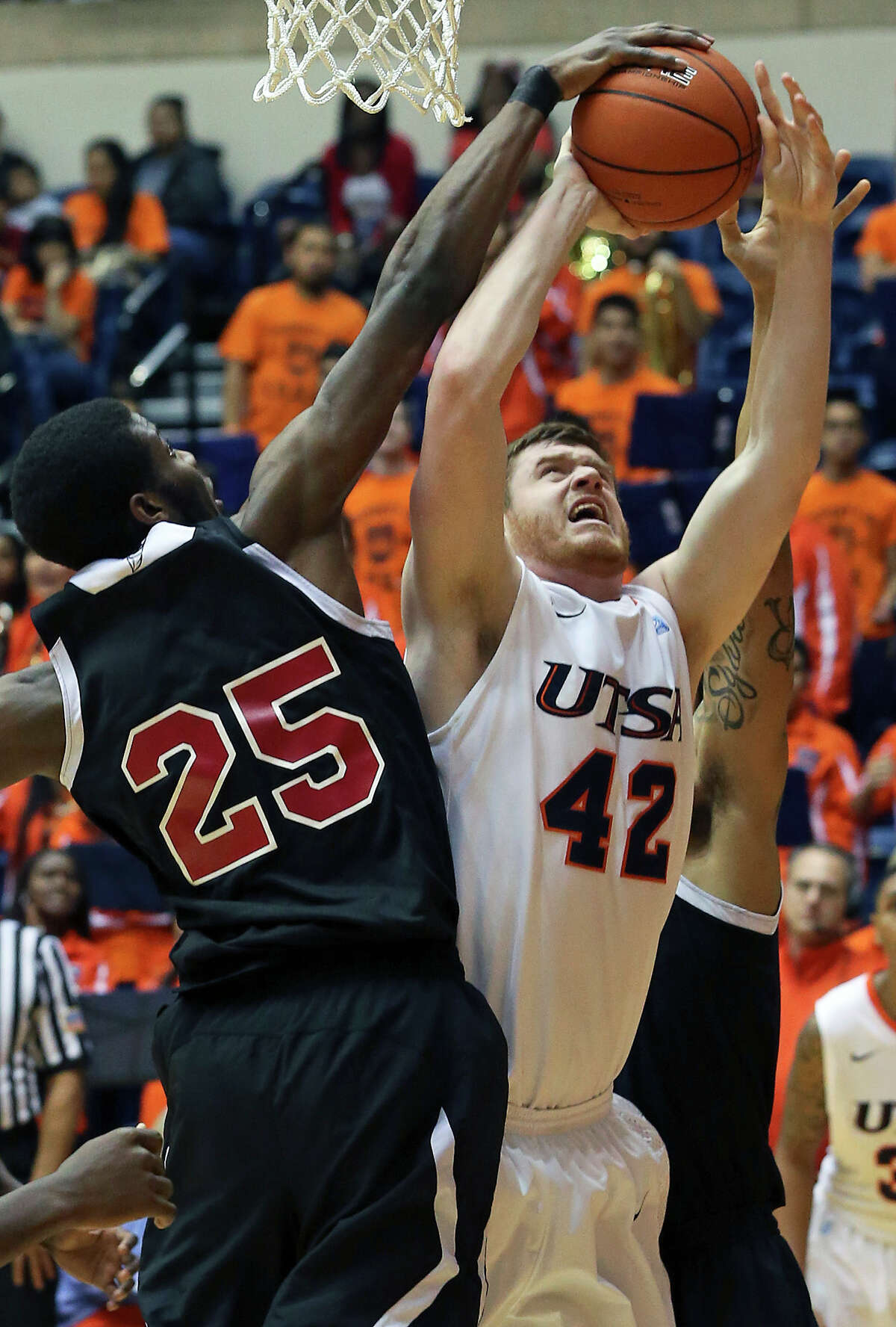 UTSA forward Tyler Wood gets blocked under the backboard by Renaldo Dixon as the Roadrunners host New Mexico State on February 2, 2013.