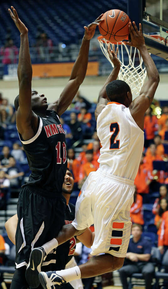 UTSA guard Hyjii Thomas gets stopped at the hoop by  Bandja Sy as the Roadrunners host New Mexico State on February 2, 2013. Photo: Tom Reel, Express-News / ©2012 San Antono Express-News