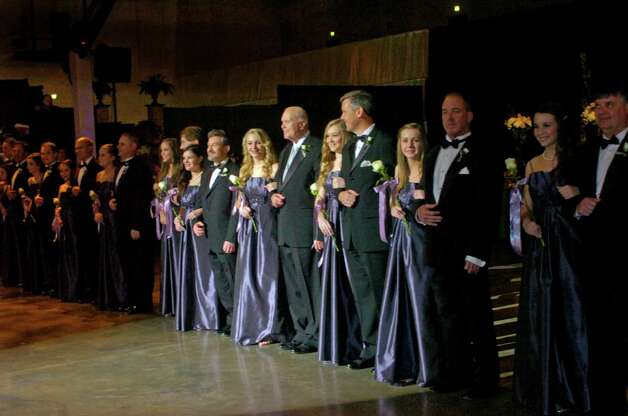 "Symphony Belles and their escorts take the floor Saturday at ""The Secret Garden,"" the annual Symphony League of Beaumont ball. The event was held at the Beaumont Civic Center. Photo: Sarah Moore"