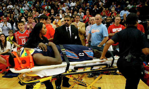 Michael Kidd-Gilchrist (14) is wheeled out of the game on a stretcher. Photo: Nick De La Torre, Chronicle / © 2010 Houston Chronicle