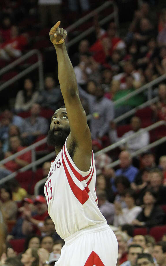 James Harden (13) keeps his finger up after hitting a three pointer. Photo: Nick De La Torre, Chronicle / © 2010 Houston Chronicle