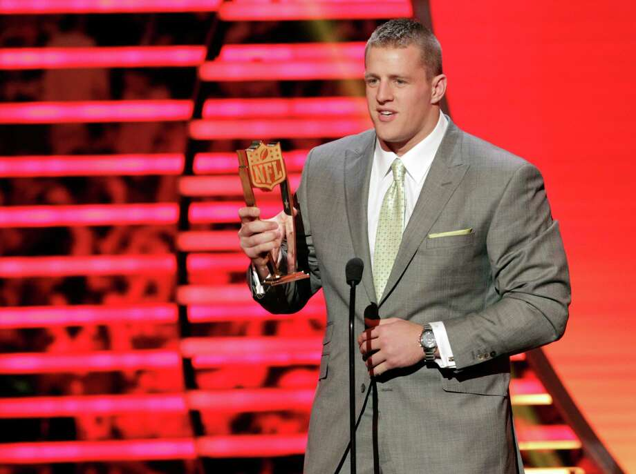 Texans defensive end J.J. Watt accepts the NFL Defensive Player of the Year honor Saturday night in New Orleans. Photo: AJ Mast, INVL / Invision
