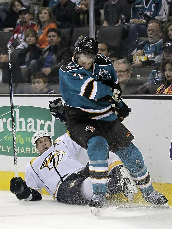San Jose Sharks defenseman Brad Stuart (7) collides with Nashville Predators center David Legwand (11) during the second period of an NHL hockey game in San Jose, Calif., on Saturday, Feb. 2, 2013. (AP Photo/Tony Avelar) Photo: Tony Avelar, Associated Press