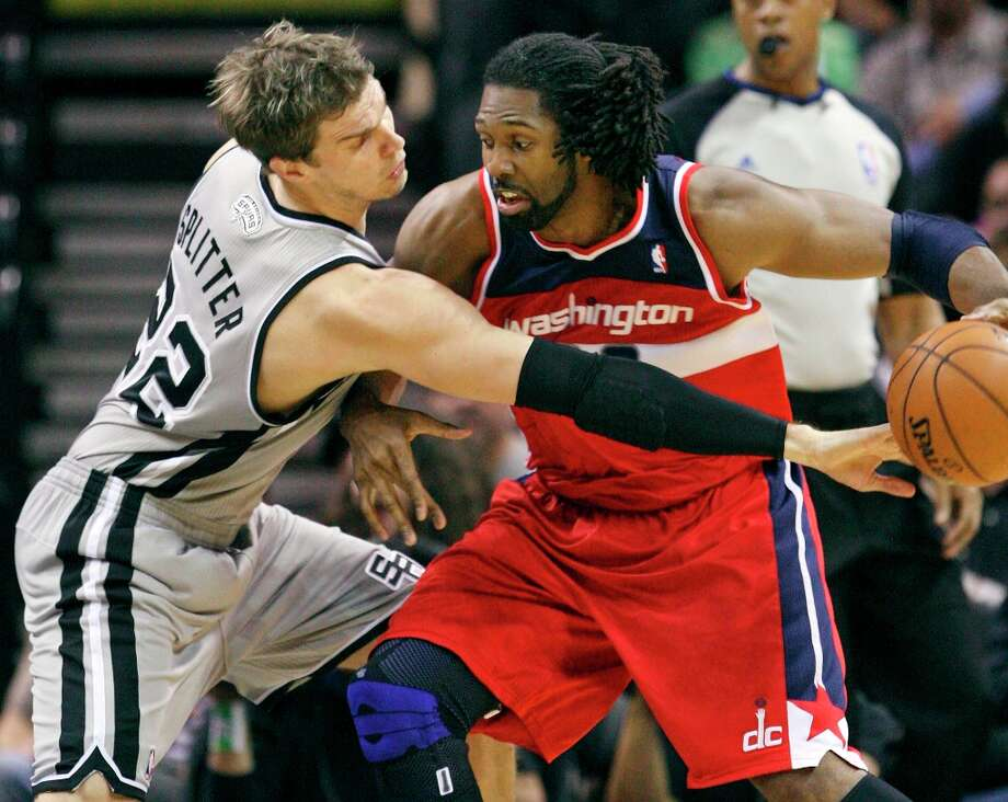 San Antonio Spurs' Tiago Splitter defends Washington Wizards' Nene during first half action Saturday Feb. 2, 2013 at the AT&T Center. Photo: Edward A. Ornelas, San Antonio Express-News / © 2013 San Antonio Express-News