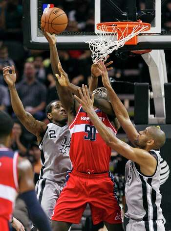San Antonio Spurs' Kawhi Leonard and Tim Duncan defend Washington Wizards' Emeka Okafor during first half action Saturday Feb. 2, 2013 at the AT&T Center. Photo: Edward A. Ornelas, San Antonio Express-News / © 2013 San Antonio Express-News