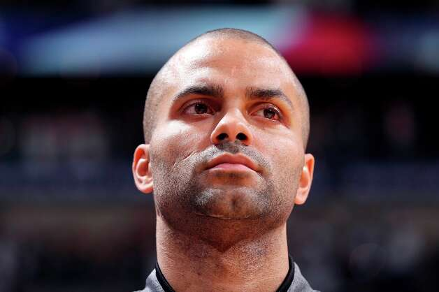 San Antonio Spurs' Tony Parker stands during the national anthem before the game with the Washington Wizards Saturday Feb. 2, 2013 at the AT&T Center. Photo: Edward A. Ornelas, San Antonio Express-News / © 2013 San Antonio Express-News