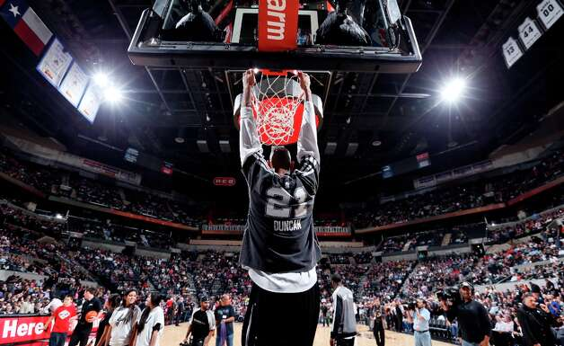 San Antonio Spurs' Tim Duncan hangs on the rim before the game with the Washington Wizards Saturday Feb. 2, 2013 at the AT&T Center. Photo: Edward A. Ornelas, San Antonio Express-News / © 2013 San Antonio Express-News