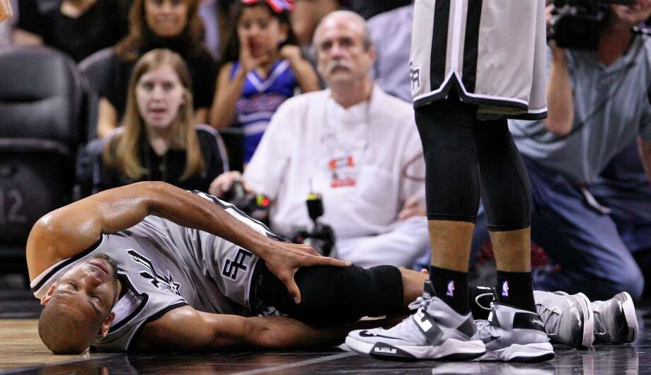 San Antonio Spurs' Tim Duncan lies on the floor after being injured on a play during first half action against the Washington Wizards Saturday Feb. 2, 2013 at the AT&T Center. Photo: Edward A. Ornelas, San Antonio Express-News / © 2013 San Antonio Express-News