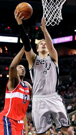 San Antonio Spurs' Tiago Splitter shoots around Washington Wizards' Kevin Seraphin during second half action Saturday Feb. 2, 2013 at the AT&T Center. The Spurs won 96-86. Photo: Edward A. Ornelas, San Antonio Express-News / © 2013 San Antonio Express-News