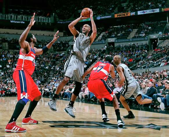 San Antonio Spurs' Tim Duncan shoots between Washington Wizards' Nene (left) and Washington Wizards' Garrett Temple as Spurs' Tony Parker looks on  during first half action Saturday Feb. 2, 2013 at the AT&T Center. Photo: Edward A. Ornelas, San Antonio Express-News / © 2013 San Antonio Express-News