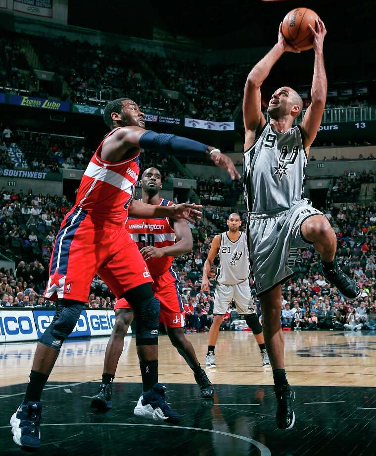 San Antonio Spurs' Tony Parker shoot against  Washington Wizards' John Wall during first half action Saturday Feb. 2, 2013 at the AT&T Center. Photo: Edward A. Ornelas, San Antonio Express-News / © 2013 San Antonio Express-News