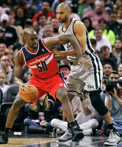 San Antonio Spurs' Tim Duncan defends Washington Wizards' Emeka Okafor during first half action Saturday Feb. 2, 2013 at the AT&T Center. Photo: Edward A. Ornelas, San Antonio Express-News / © 2013 San Antonio Express-News