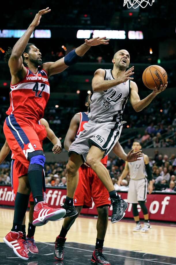 San Antonio Spurs' Tony Parker shoots around  Washington Wizards' Nene during second half action Saturday Feb. 2, 2013 at the AT&T Center. The Spurs won 96-86. Photo: Edward A. Ornelas, San Antonio Express-News / © 2013 San Antonio Express-News