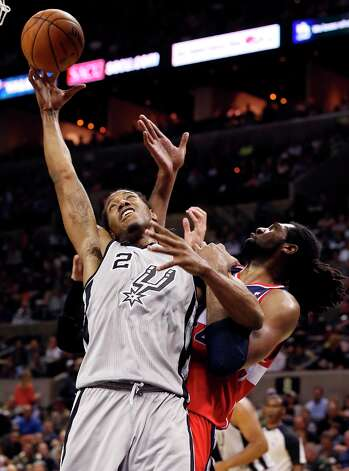 San Antonio Spurs' Kawhi Leonard grabs for a rebound against Washington Wizards' Nene during second half action Saturday Feb. 2, 2013 at the AT&T Center. The Spurs won 96-86. Photo: Edward A. Ornelas, San Antonio Express-News / © 2013 San Antonio Express-News