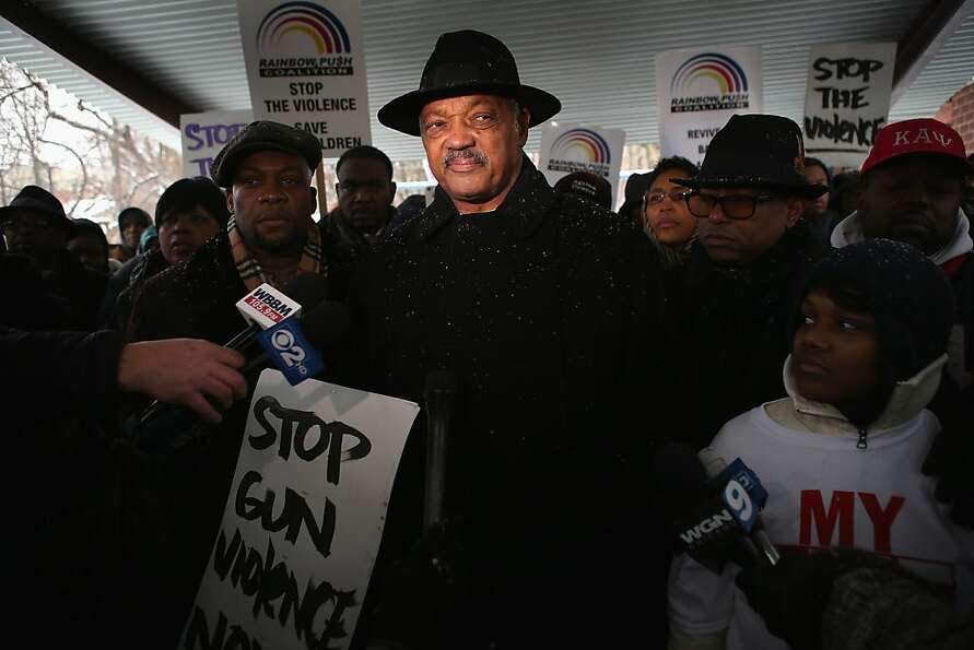 Rev. Jesse Jackson leads a march calling for an end to gun violence from Dr. Martin Luther King Jr.