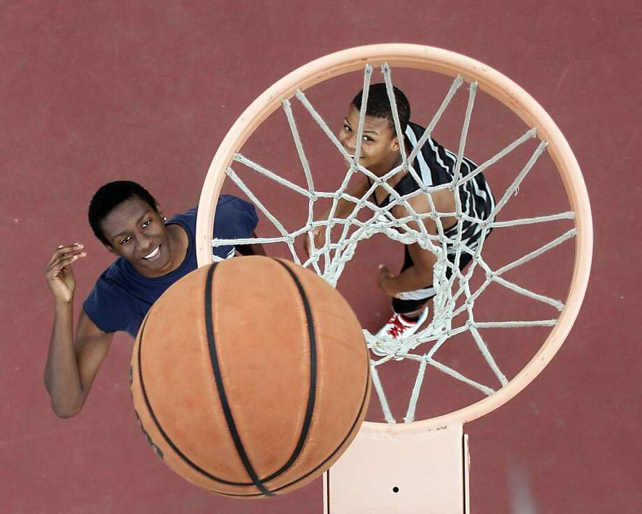 Myron Wright, left, shoots a layup past Lavery Shepherd during a game of one-on-one basketball at Dr. Martin Luther King, Jr. Sports Park on Saturday, Feb. 2, 2013, in Conroe, Texas.  Photo: Jason Fochtman, Associated Press