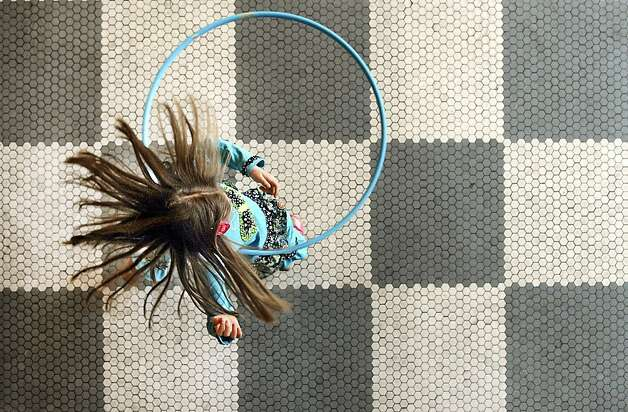 6-year-old Cadence Kleinfeld spins while playing with a Hula Hoop at the Ready, Set, Explore event at the Susan Byrnes Health Center in York, Pa. on Saturday, Feb. 2, 2013.  Photo: Jason Plotkin, Associated Press