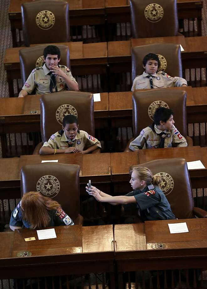 Scouts sit in the House Chambers at the Texas State Capitol as they wait to hear Gov. Rick Perry speak during the annual Boy Scouts Parade and Report to State, Saturday, Feb. 2, 2013, in Austin, Texas. Perry says he hopes the Boy Scouts of America doesn't move soften its mandatory no-gays membership policy. Photo: Eric Gay, Associated Press