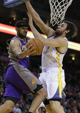 Phoenix Suns' Jared Dudley, left, looks to pass away from Golden State Warriors' Andrew Bogut in the first half of an NBA basketball game Saturday, Feb. 2, 2013, in Oakland, Calif. (AP Photo/Ben Margot) Photo: Ben Margot, Associated Press