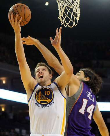 Golden State Warriors forward David Lee (10) is fouled by Phoenix Suns Luis Scola (14) in the first half of their NBA basketball game Saturday, Feb. 2, 2013 at the Oakland Coliseum in Oakland California. Photo: Lance Iversen, The Chronicle